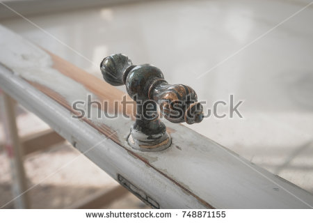 stock-photo-metal-handle-on-old-wooden-window-during-restoration-closeup-748871155
